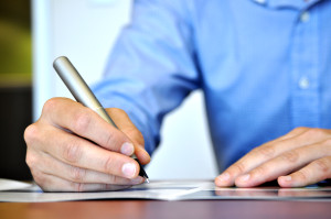 Man writing search engine optimised copy for his website